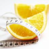 Oranges et mesure Photographie stock libre de droits