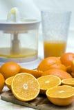Oranges et mélangeur Photos stock
