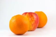 Oranges et pommes Photographie stock libre de droits