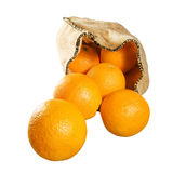 Oranges falling from sack isolated Stock Photography