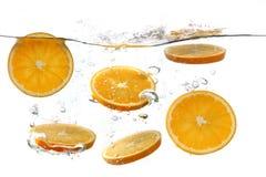 Oranges Falling Into Splashing Clear Water Stock Image