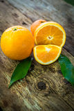 Oranges on the floor. And two leaves Stock Photo
