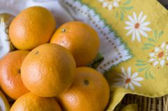 Oranges on floral napkin Royalty Free Stock Images