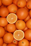 Oranges forming a fruits background Stock Photos