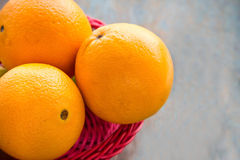 Oranges. Fresh oranges in a basket. Oranges close-up stock image royalty free stock photo