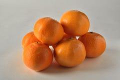 Oranges. Fresh and healthy oranges  on white/grey background Royalty Free Stock Image