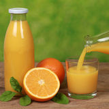 Oranges and fresh juice Royalty Free Stock Images