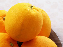 Oranges. The fresh oranges on plate Royalty Free Stock Photography