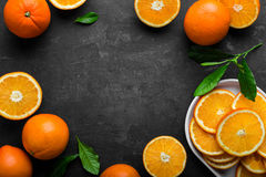 Oranges. Fresh sliced oranges with leaves royalty free stock photos