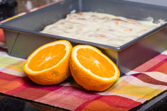Oranges with fresh sweet rolls Stock Images