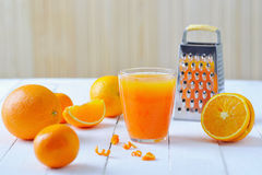Oranges and freshly squeezed juice Royalty Free Stock Photo