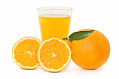 Oranges and freshly squeezed orange juice Royalty Free Stock Images