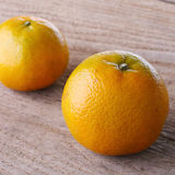 Oranges fruit on brown wood Royalty Free Stock Images