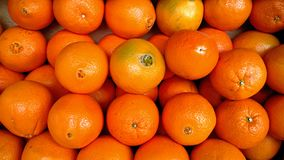 Oranges in fruit market stall. Pile of ripe oranges at a urban fruit market retail stand. Fruit stall image for advert Stock Photos