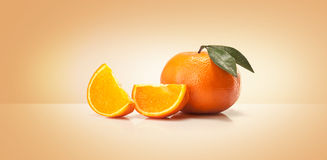 Oranges fruit and orange wedge Royalty Free Stock Image