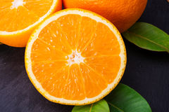 Oranges fruts close up. Oranges on a Plate stone Royalty Free Stock Images