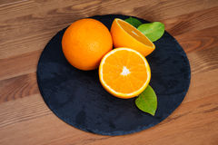 Oranges fruts. Oranges on a Plate stone Royalty Free Stock Images