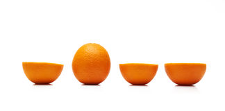 Oranges. Full and halves of oranges in a row Royalty Free Stock Photo