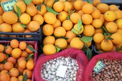 Oranges, garlic and onion on the market Royalty Free Stock Photography