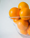 Oranges glass bowl Royalty Free Stock Images