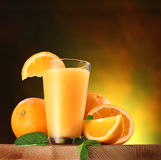 Oranges and glass of juice. Royalty Free Stock Photography