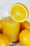 Oranges and glass of orange juice Royalty Free Stock Photo