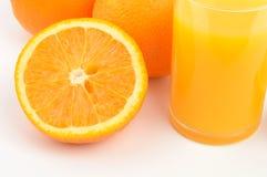 Oranges. And glass of orange juice Royalty Free Stock Photo