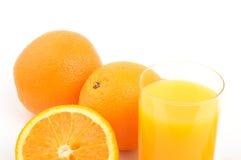 Oranges. And glass of orange juice Royalty Free Stock Photos