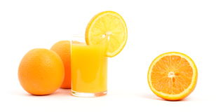 Oranges. And a glass of orange juice isolated on white Royalty Free Stock Images