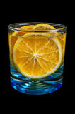 Oranges on a glass in a white background Stock Images