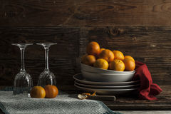 Oranges and glasses. Stock Images