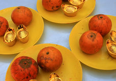 Oranges and gold ingot Royalty Free Stock Images