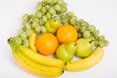 Oranges Grapes Bananas and Pears on White Royalty Free Stock Images
