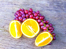 Oranges and grapes Stock Images