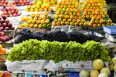 Oranges and grapes for sale marketplace royalty free stock image