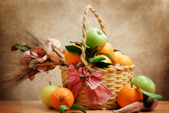 Oranges and green apple inside wicker basket Royalty Free Stock Image
