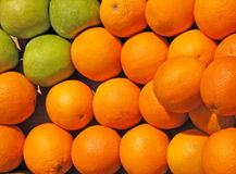 Oranges and green apples Royalty Free Stock Photography