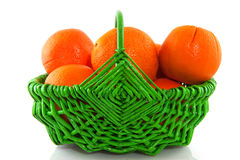 Oranges in green basket Royalty Free Stock Photography