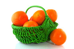 Oranges in green basket Stock Photography