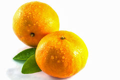 Oranges with green leaves. Over white background Stock Photo