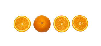 Oranges. Halves of oranges and one full orange Royalty Free Stock Image