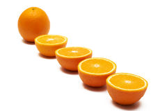 Oranges. Halves and one full orange Royalty Free Stock Image