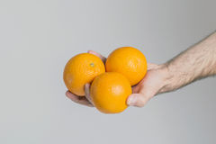 Oranges in hand Royalty Free Stock Photos