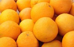 Oranges. Heap of oranges on a horizontal photo Stock Photo
