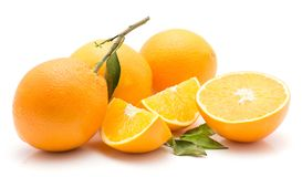 Orange, appelsin isolated. Oranges isolated on white background three whole two sliced quarters one half green leaves Stock Images