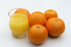 Oranges and juice. On the white background Stock Images