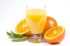 Oranges and juice. Some fresh orange juice and oranges royalty free stock photos