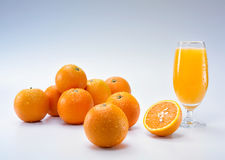 Oranges and juice Royalty Free Stock Photography