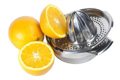 Oranges and juice extractor Royalty Free Stock Photo