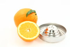 Oranges and juice extractor Royalty Free Stock Images